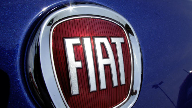 FILE - This July 8, 2012 file photo shows Chrysler's Fiat logo at an auto dealership in Springfield, Ill. Italian automaker Fiat has exercised a third option to buy a small amount of Chrysler stock, but the sale won't go through until a U.S. court settles a dispute over the price. Fiat said Monday, July 8, 2013 that it offered $254.7 million for another 3.3 percent of Chrysler's outstanding equity. (AP Photo/Seth Perlman, file)