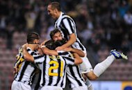 Juventus defender Giorgio Chiellini (top) celebrates with teammates, at the end of their Italian Serie A match against Cagliari at Nereo Rocco stadium in Trieste. Having gone the entire season unbeaten with one match to play, no-one could begrudge Juventus their 28th Italian league title, secured with a 2-0 victory over Cagliari on Sunday