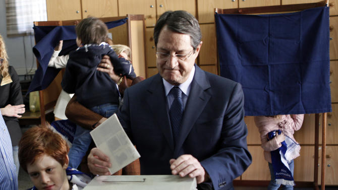 Right-wing opposition leader and presidential candidate Nicos Anastasiades votes in the Presidential election in southern port city of Limassol, Cyprus, Sunday, Feb. 17, 2013. Cypriots are voting for a new president amid a financial crisis in which the country needs a rescue package from international creditors to stave off bankruptcy. (AP Photo/Petros Karadjias)