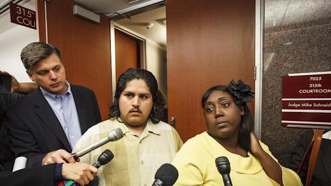 FILE - In a Wednesday, March 21, 2012 file photo, Fernando Morin, center, and Auboni Champion-Morin, right, speak to the media after an emergency court hearing to reveal the results of the DNA tests for the Morin-Champion case outside the 315th State District Court of the Juvenile Justice Center, in Houston.  A Texas judge is expected to make a decision Wednesday, March 28, 2012 on the fate of 8-year-old Miguel Morin after a court hearing. Fernando Morin and his wife, Auboni Champion-Morin, are seeking to regain custody of the child who's been in foster care since he was found in San Augustine, about 140 miles northeast of Houston.  (AP Photo/Houston Chronicle, Michael Paulsen, File)    MANDATORY CREDIT