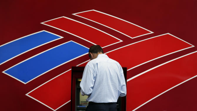 A customer uses a Bank of America ATM in downtown Charlotte, N.C., Tuesday, July 16, 2013. Bank of America Corp. reports quarterly financial results before the market open on Wednesday, July 17, 2013. (AP Photo/Chuck Burton)