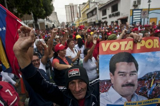 Supporters of Venezuelan President Nicolas Maduro demonstrate in Los Teques, on April 17, 2013. Maduro steamrolled toward inauguration as Venezuela's president Thursday despite days of flaring tensions over opposition demands for a recount in elections to replace Hugo Chavez.