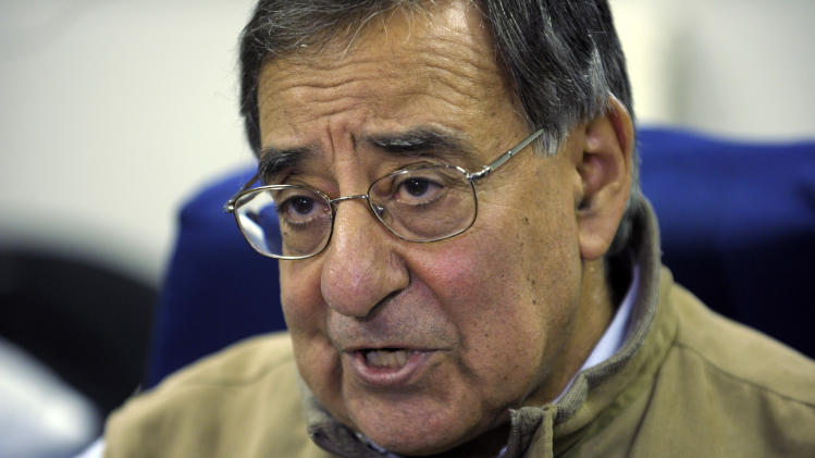 Defense Secretary Leon Panetta talks to reporters while on board his plane headed to Kuwait, Tuesday, Dec. 11, 2012. Panetta will meet with troops as part of a visit to thank the troops for their service. (AP Photo/Susan Walsh, Pool)