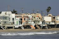 Luxurious beach houses crowd the shoreline hiding Carbon Beach.