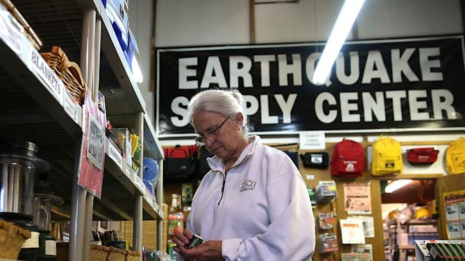 Margaret Harrington inspects a lantern while shopping for earthquake supplies at Earthquake Supply Center on August 27, 2014, in San Rafael, California.