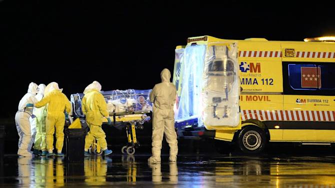 A Spanish Defense Ministry photo shows aid workers and doctors transferring Catholic missionary Manuel Garcia Viejo, who contracted the deadly Ebola virus, upon his arrival in Spain on September 22, 2014