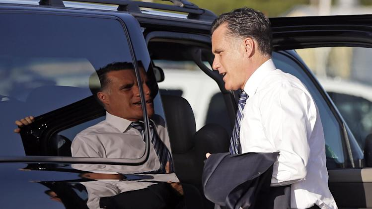 Republican presidential candidate and former Massachusetts Gov. Mitt Romney gets in his vehicle as he arrives at Love Field in Dallas, Tuesday, Sept. 18, 2012.  (AP Photo/Charles Dharapak)