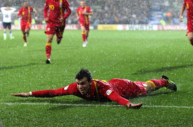 Wales's Gareth Bale celebrates scoring his side's winning goal in the rain in Cardiff