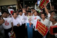 "This file photo shows supporters of Myanmar's political prisoners welcoming amnestied prisoners, in Yangon, on July 4, 2012. Country's leader has set up a committee to review political prisoner cases ""to grant them liberty"", state media said Thursday, in a rare direct acknowledgement of dissidents in the nation's jails"