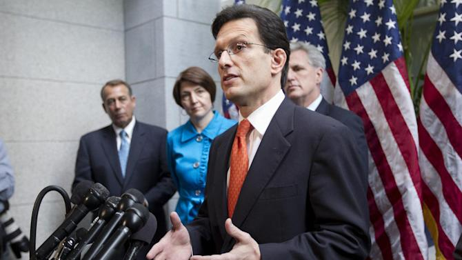 FILE - In this Feb. 15, 2012, file photo, House Majority Leader Eric Cantor of Va., accompanied by fellow  GOP leaders, gestures during a news conference on Capitol Hill in Washington, to discuss the payroll tax cut negotiations. From left are, House Speaker John Boehner of Ohio, Rep. Cathy McMorris Rodgers, R-Wash., Cantor, and House Majority Whip Kevin McCarthy, R-Calif. Republicans are using a House vote on tax cuts for nearly every employer in the country to make an election-year statement that they want to help companies create jobs. Democrats say the measure is merely the latest GOP effort to funnel federal help to those who are already successful. The GOP-run House was ready to approve the legislation on Thursday, April 19, 2012, in a vote lacking either suspense or any expectation that the plan would become law. (AP Photo/J. Scott Applewhite, File)