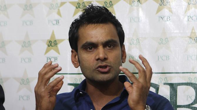 Pakistan Twenty20 captain Mohammad Hafeez addresses a press conference in Lahore, Pakistan, Wednesday, March 12, 2014. Hafeez hoped Shahid Afridi gets fit in time to play in World Twenty20 after hard-hitting allrounder delayed his departure to Bangladesh to recover from hamstring injury. (AP Photo/K.M. Chaudary)