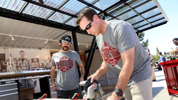 "IMAGE DISTRIBUTED FOR CRAFTSMAN - EXCLUSIVE - Actor and comedian Rob Riggle, right, teams up with MAKE magazine executive editor Mike Senese on a woodworking project at the Craftsman MAKEcation on Sat., Aug. 30, 2014, in Lake Arrowhead, Calif. The Craftsman MAKEcation is the ultimate ""making"" vacation where attendees learn skills from hardcore blacksmiths, rugged woodworkers and cigar rolling experts. Visit Twitter.com/Craftsman to follow the event in real time. (Photo by Casey Rodgers/Invision for Craftsman/AP Images)"