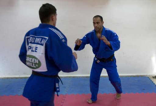 Palestinian judo champion Maher Abu Rmeileh, 28 (R), trains with a teammate in Jerusalem, on May 24. Rmeileh, who comes from east Jerusalem, has become the first Palestinian to qualify on points for the Olympics, winning entry to the London Games
