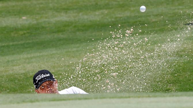 Australia's Jones hits out of a bunker during his win in the final round of the 2015 Australian Open Golf tournament in Sydney