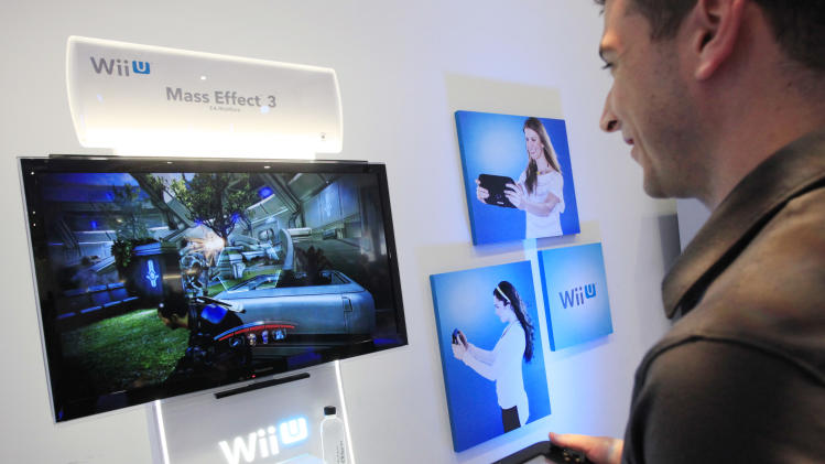 Nintendo's Wii U GamePad and console are unveiled, Thursday, Sept. 13, 2012 in New York. The gaming console will start at $300 and go on sale in the U.S. on Nov. 18, in time for the holidays, the company said Thursday. (AP Photo/Mark Lennihan)