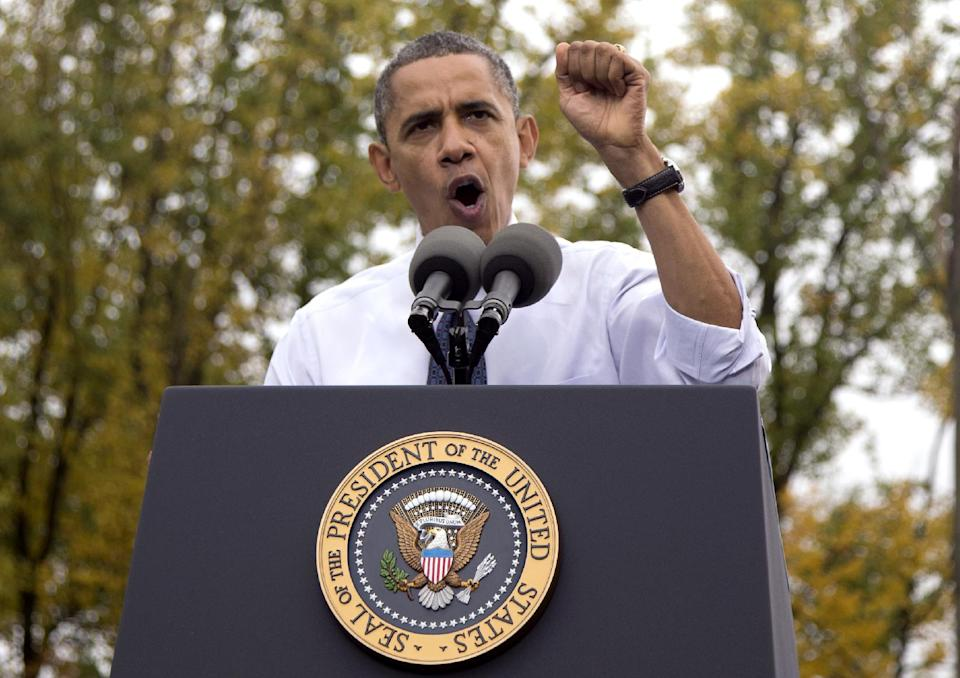 President Barack Obama gestures as he speaks about the choice facing women in the upcoming election, Friday, Oct. 19, 2012, at a campaign event at George Mason University in Fairfax, Va. (AP Photo/Carolyn Kaster)