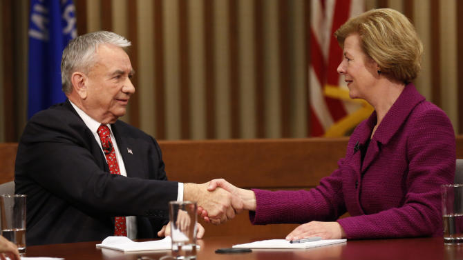 Republican candidate for Wisconsin's U.S. Senate seat, former Gov. Tommy Thompson, left shakes hands with Democratic candidate U.S. Rep. Tammy Baldwin at the end of their Senate debate at Marquette University Friday, Oct. 26, 2012, in Milwaukee. (AP Photo/Jeffrey Phelps)