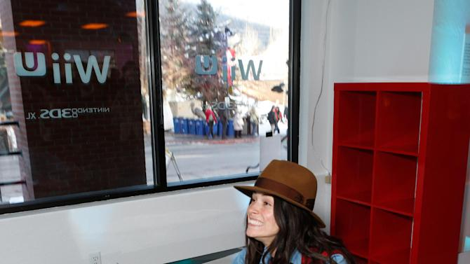 IMAGE DISTRIBUTED FOR NINTENDO - Actress Abigail Spencer warms up and checks out Wii U at the Nintendo Lounge while playing Wii Fit U during a break from the Sundance Film Festival on Monday, Jan. 21, 2013 in Park City, Utah. (Photo by Todd Williamson/Invision for Nintendo/AP Images)
