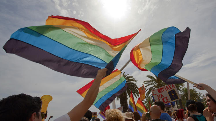 Gay rights activists  with rainbow flags attend  a Gay Pride march in Split, Croatia, Saturday, June 9, 2012. (AP Photo/Nikola Solic)
