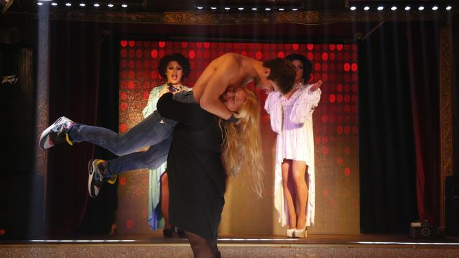 """Visitors take to the floor during a cabaret show at Mayak, one of the two gay clubs in the Black Sea resort of Sochi, Russia, Monday, Sept. 23, 2013. Sochi, a southern Russian town, will host the Winter Olympics amid President Vladimir Putin's harsh crackdown on gays. The morality campaign, centered on a law banning homosexual """"propaganda,"""" has threatened to overshadow the games as it provokes an international outcry. (AP Photo/Sergei Grits)"""