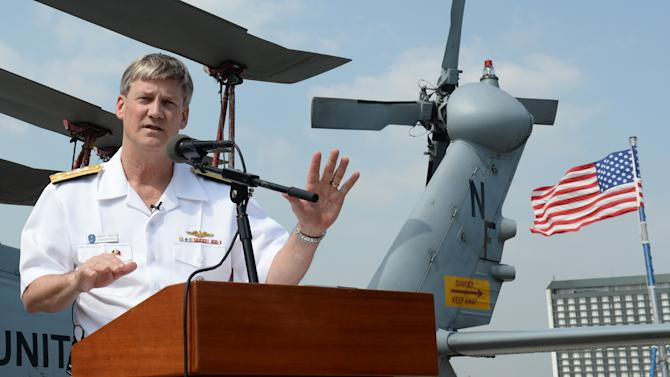 US vice admiral Robert Thomas Jr speaks during a press conference aboard the USS Blue Ridge command ship shortly after arriving at the international port in Manila on March 18, 2014, for a port visit