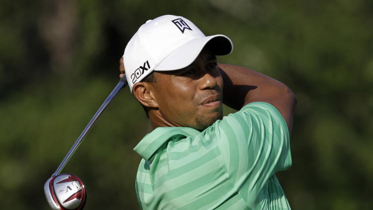 Tiger Woods watches his tee shot on the 11th hole during the second round of the Greenbrier Classic PGA Golf tournament at the Greenbrier in White Sulphur Springs, W. Va., Friday, July 6, 2012. Woods missed the cut. (AP Photo/Steve Helber)