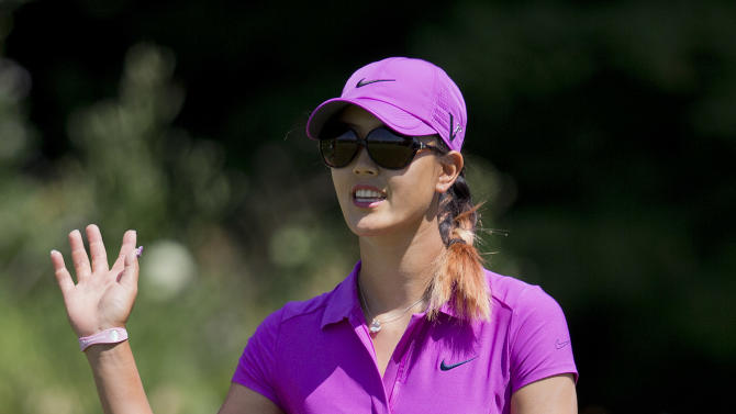 Michelle Wie waves to the crowd on the first green during the final round of the U.S. Women's Open golf tournament on Sunday, July 8, 2012, in Kohler, Wis. (AP Photo/Julie Jacobson)
