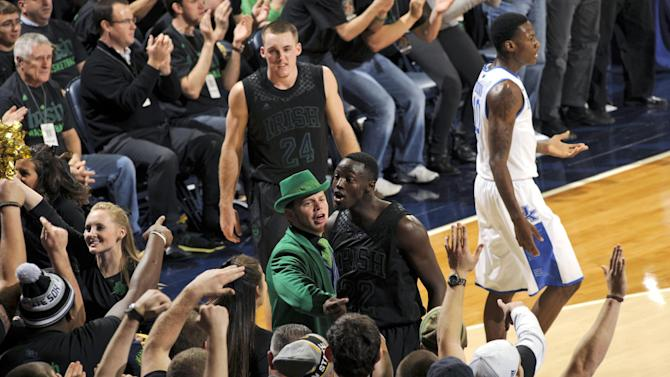 Notre Dame guard Jerian Grant, lower center, stands near fans as he reacts to a basket during the first half of an NCAA college basketball game against Kentucky on Thursday, Nov. 29, 2012, in South Bend, Ind. (AP Photo/Joe Raymond)