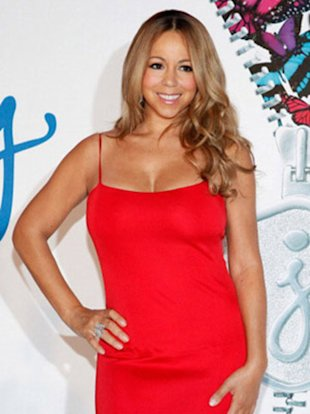 Mariah knows how to work her new mommy body.