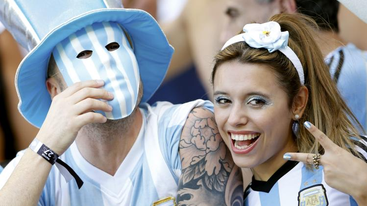Fans cheer before the 2014 World Cup Group F soccer match between Argentina and Iran at the the Mineirao stadium in Belo Horizonte
