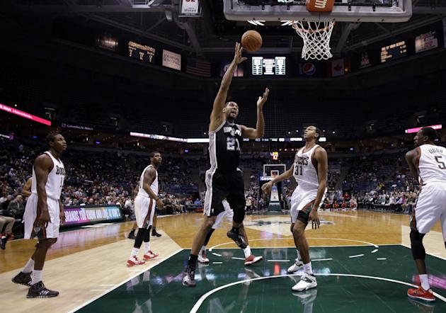 San Antonio Spurs' Tim Duncan puts up a shot during the second half of an NBA basketball game against the Milwaukee Bucks Wednesday, Dec. 11, 2013, in Milwaukee