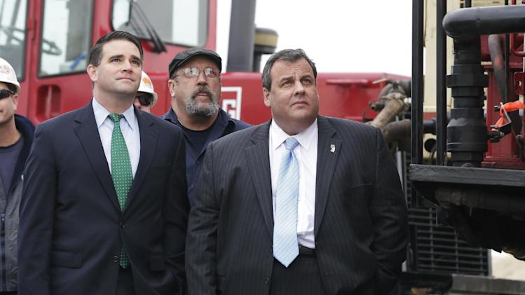 In this Wednesday, Jan. 9, 2013 photo, New Jersey Gov. Chris Christie, right, Belmar Mayor Matt Doherty, left, and others watch a pile-driver during a ceremony to kick off the construction of a new boardwalk in Belmar, N.J., to replace the walkway destroyed by Superstorm Sandy in October 2012. The stop was one of many on Gov. Christie's schedule following his State of the State message this week. With his popularity and visibility at record highs after Superstorm Sandy, Democrats are wondering if there is anyone left in the party to challenge him for re-election, beyond the one declared candidate who is not the first choice of the party establishment. (AP Photo/Mel Evans)
