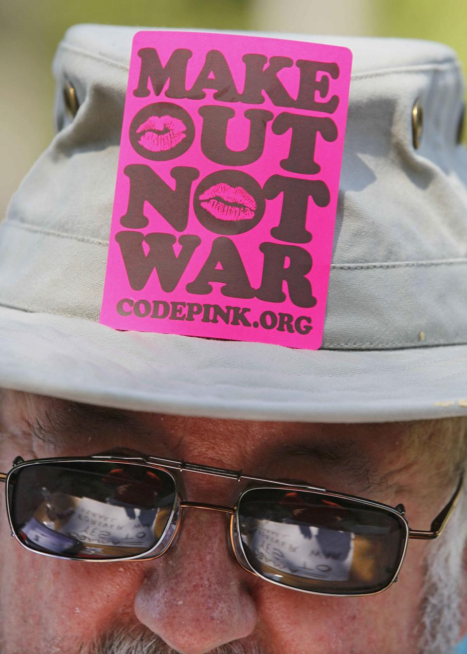 Bill Fisk, of Henderson, N.C. works on protest signs during a rally, Sunday, Sept. 2, 2012, in Charlotte, N.C. Demonstrators are protesting and marching before the Democratic National Convention. (AP Photo/Gerry Broome)