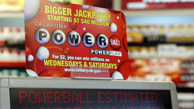 A sign at a store advertises the Powerball Lottery in Oklahoma City, Friday, May 17, 2013. Powerball officials say the jackpot has climbed to an estimated $600 million, making it the largest prize in the game's history and the world's second largest lottery prize. (AP Photo/Sue Ogrocki)