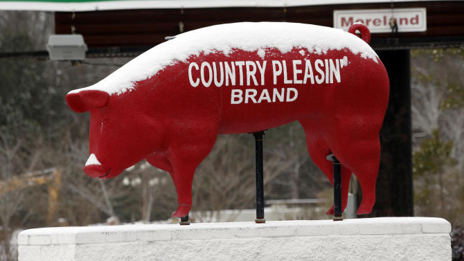 A store's hog mascot is crusted with snow and ice in Florence, Miss., Tuesday, Jan. 28, 2014 as ice and snow flurries blanket the state. A severe winter storm hit the South bringing ice, snow and below freezing temperatures. (AP Photo/Rogelio V. Solis)