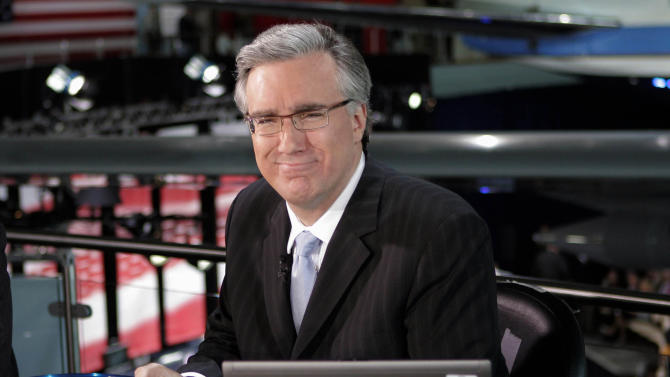 FILE - In this May 3, 2012 file photo, Keith Olbermann poses at the Ronald Reagan Library in Simi Valley, Calif.   Olbermann and Current TV say they've settled their dispute nearly a year after Olbermann was fired by the network and responded with a $50 million lawsuit. Both parties say in a Wednesday, March 13, 2013 statement that the terms of the settlement are confidential. Olbermann was fired last March as a host and executive at the left-leaning cable talk network.  (AP Photo/Mark J. Terrill, File)