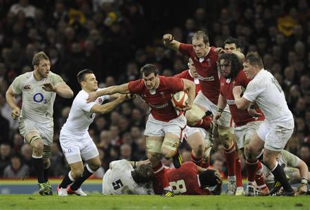 Wales' Warburton runs with the ball during their Six Nations international rugby union match against England at the Millennium Stadium in Cardiff