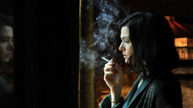 "In this film image released by Music Box Films, Rachel Weisz portrays Hester Collyer in a scene from ""The Deep Blue Sea."" On Monday, Dec. 3, 2012, The New York Film Critics Circle announced their picks for best film and the top performances of the year, one of the first major awards in the drumbeat ahead of the Academy Awards. Weisz earned best actress from the critics for her performance in the little-seen ""The Deep Blue Sea,"" a period drama by the British director Terence Davies.  (AP Photo/Music Box Films)"