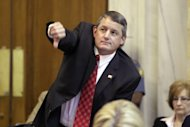 In this April 16, 2013 photo, Arkansas House Majority Leader Rep. Bruce Westerman, R-Hot Springs, signals his intention to speak against a Medicaid funding bill in the House chamber at the Arkansas state Capitol in Little Rock, Ark., Tuesday, April 16, 2013. The funding provision passed. (AP Photo/Danny Johnston)