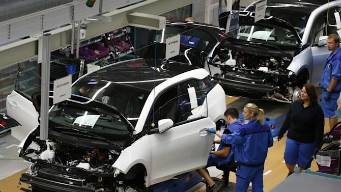 Workers assemble BMW i3 electric cars at the production line of the BMW factory in Leipzig