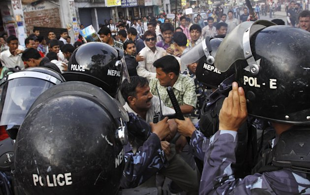 Activists of Nepal's opposition parties scuffle with police during a demonstration against Prime Minister Baburam Bhattarai in Katmandu, Nepal, Wednesday, May 30, 2012. The opposition parties said they will team up to topple the government, as they accused the prime minister Wednesday of having no moral or legal grounds to stay in power ahead of new elections. (AP Photo/Binod Joshi)