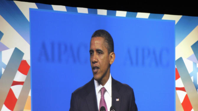 """President Barack Obama is seen on a large screen video screen as he addresses the American Israel Public Affairs Committee (AIPAC) Policy Conference opening plenary session in Washington, Sunday, March 4, 2012. Speaking to the powerful pro-Israel lobby, Obama appealed to Israel for more time to let sanctions further isolate Iran. He said """"too much loose talk of war"""" recently has only helped Tehran and driven up the price of oil. (AP Photo/Cliff Owen)"""