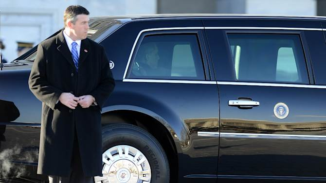 President Barack Obama waits in his limousine for the start of the Inaugural Parade following the Presidential review of the troops on the east side of the Capitol in Washington, Monday, Jan. 21, 2102, following his inaugural address and ceremonially swearing-in during the 57th Presidential Inauguration. (AP Photo/CJ Gunther, Pool)