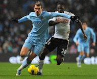 Manchester City&#39;s Bosnian striker Edin Dzeko (left) during a match against Fulham in February. Bayern Munich are lining up a bid for Dzeko in the hope of partnering the Bosnian with their top scorer Mario Gomez, according to a report on Thursday