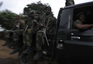 Democratic Republic of Congo government soldiers ride on a truck in Minova, 70 kilometres south of Goma. Congolese rebels on Sunday rejected demands by regional governments to pull out of the eastern city of Goma to allow for peace talks aimed at preventing a wider conflict and halting a spiralling humanitarian catastrophe.