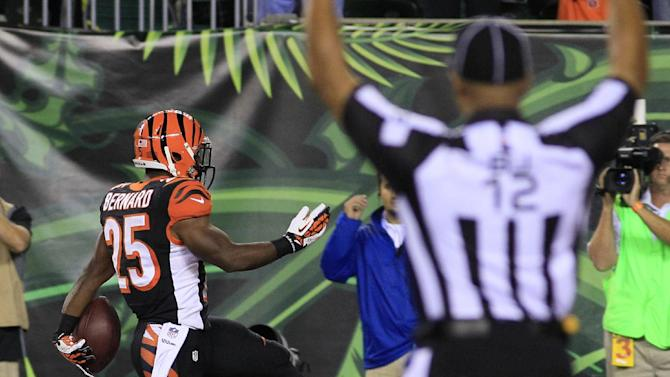 CORRECTS TO SECOND HALF-Cincinnati Bengals running back Giovani Bernard (25) scores a touchdown on a 27-yard pass reception against the Pittsburgh Steelers in the second half of an NFL football game, Monday, Sept. 16, 2013, in Cincinnati. (AP Photo/Tom Uhlman)