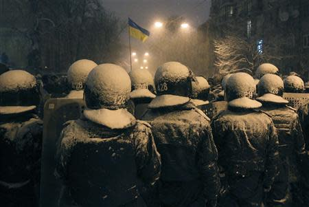 Interior Ministry personnel block a street during a gathering of supporters of EU integration in Kiev