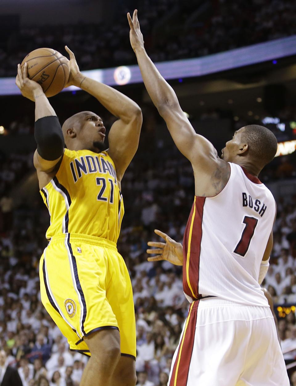 Indiana Pacer forward David West (21) drives to the basket as Miami Heat center Chris Bosh (1) defends during the first half of Game 2 in their NBA basketball Eastern Conference finals playoff series, Friday, May 24, 2013, in Miami. (AP Photo/Lynne Sladky)