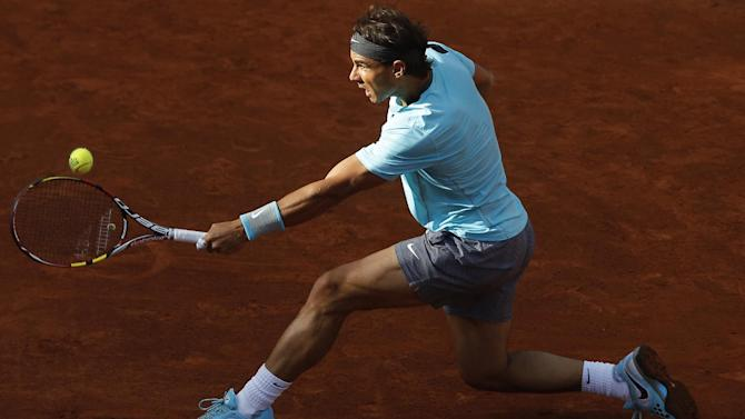 Spain's Rafael Nadal returns the ball during the quarterfinal match of the French Open tennis tournament against compatriot David Ferrer at the Roland Garros stadium, in Paris, France, Wednesday, June 4, 2014
