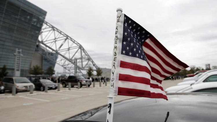 A flag flutters in the wind before a memorial service for Christopher Kyle at Cowboys Stadium, Monday, Feb. 11, 2013, in Arlington, Texas. Thousands are expected to attend the public memorial service for Kyle, the former Navy SEAL sniper who was shot to death at a Texas shooting range. (AP Photo/Brandon Wade)
